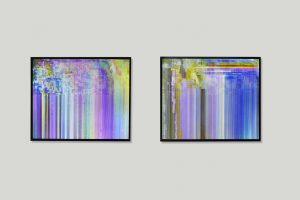 Two photographic lightboxes displaying a corrupted video file.