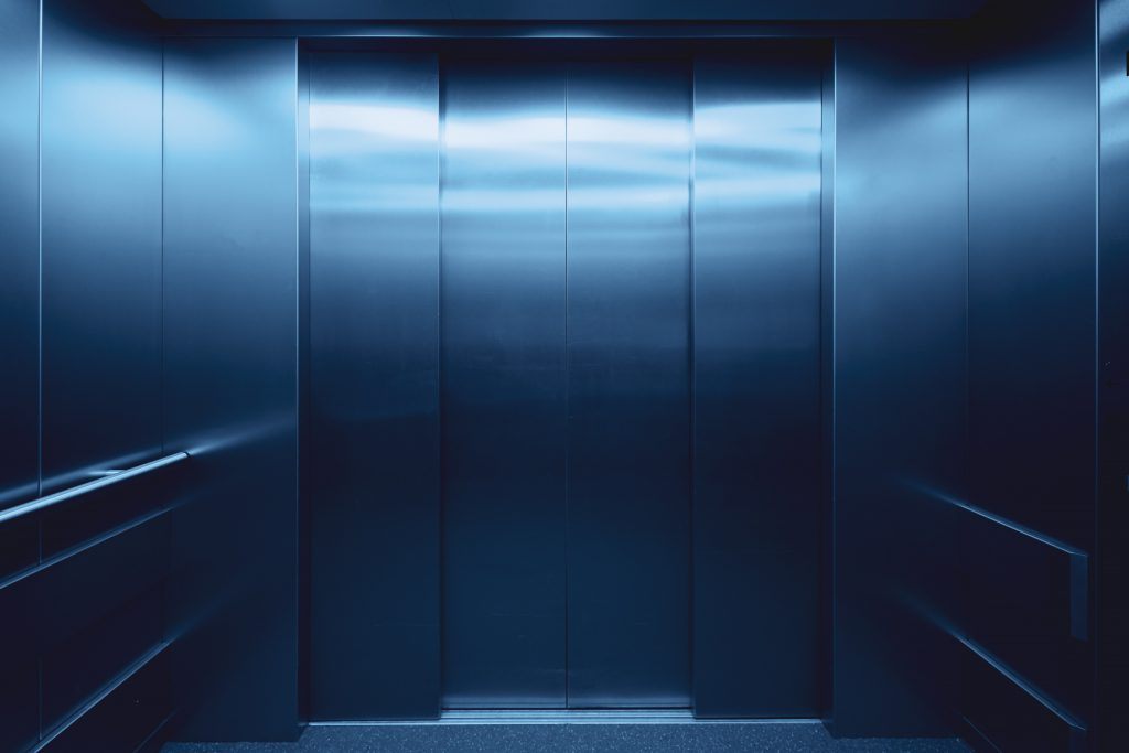An elevator door, representing access to all floors regardless of physical circumstances