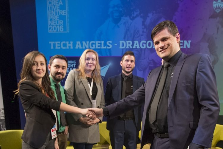 Lavinia shaking hands with the Tech Angels judging panel