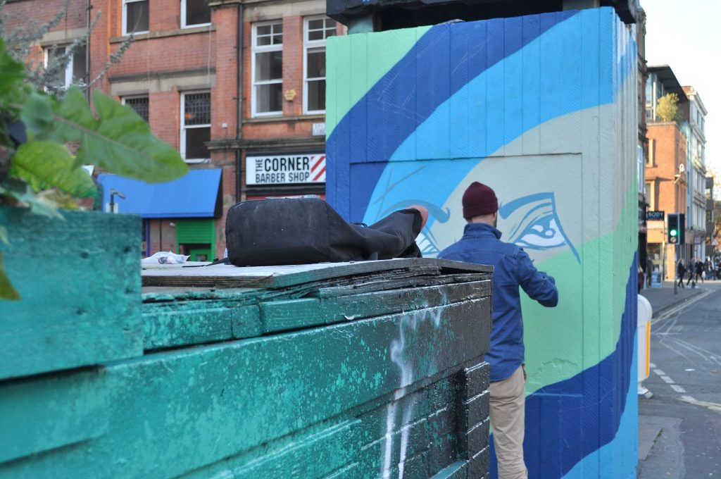 A new piece of street art being painted in Stevenson Square