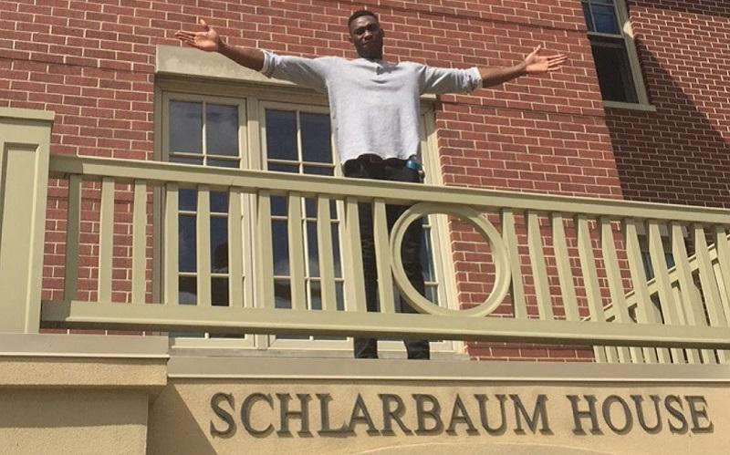 Emmanuel standing above his student halls
