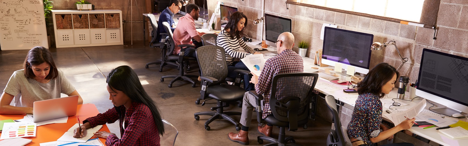 Image: a group of people working in an office