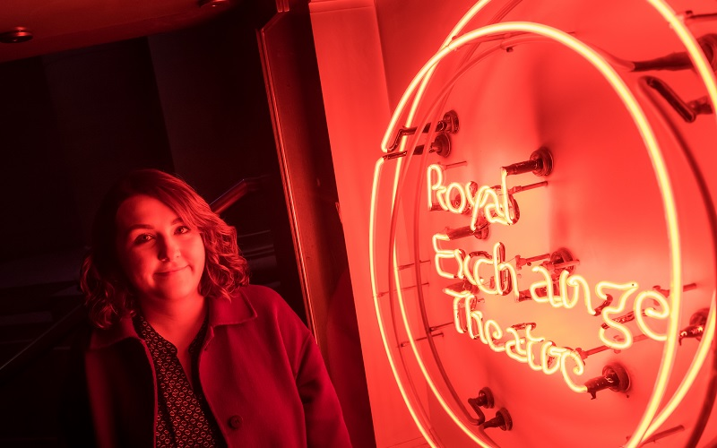 A neon red Royal Exchange Theatre sign