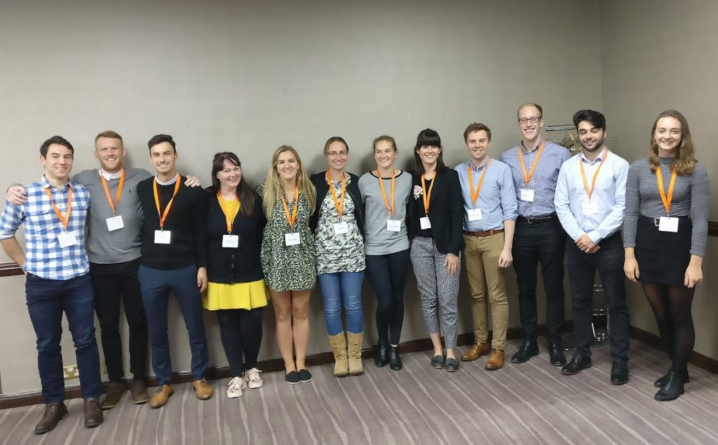 Image: Claire with other interns at the BASEM conference