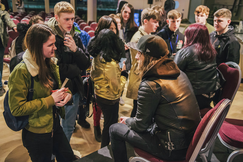 Image: School students interacting with Blossoms tour manager Dan Woolfie