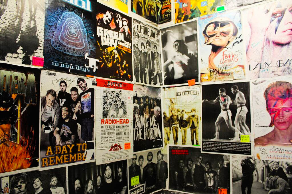 Image: Poster covered wall in Afflecks Palace