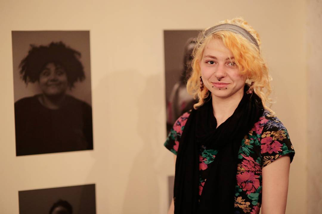 Image: Salford University student Alena Donely portrait with her visual arts work