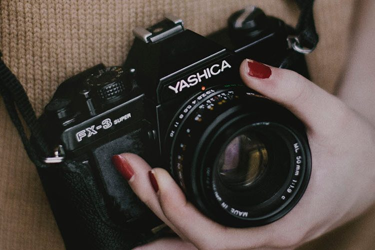 Image: Film camera in womans hand