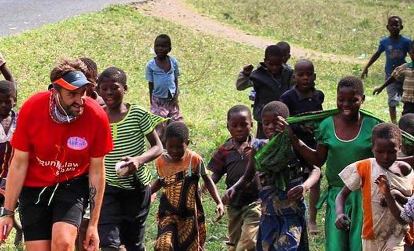 Image: Brendan running accompanied by children