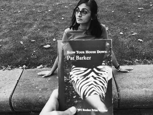 Image: Salma playing along with #BookFaceFriday