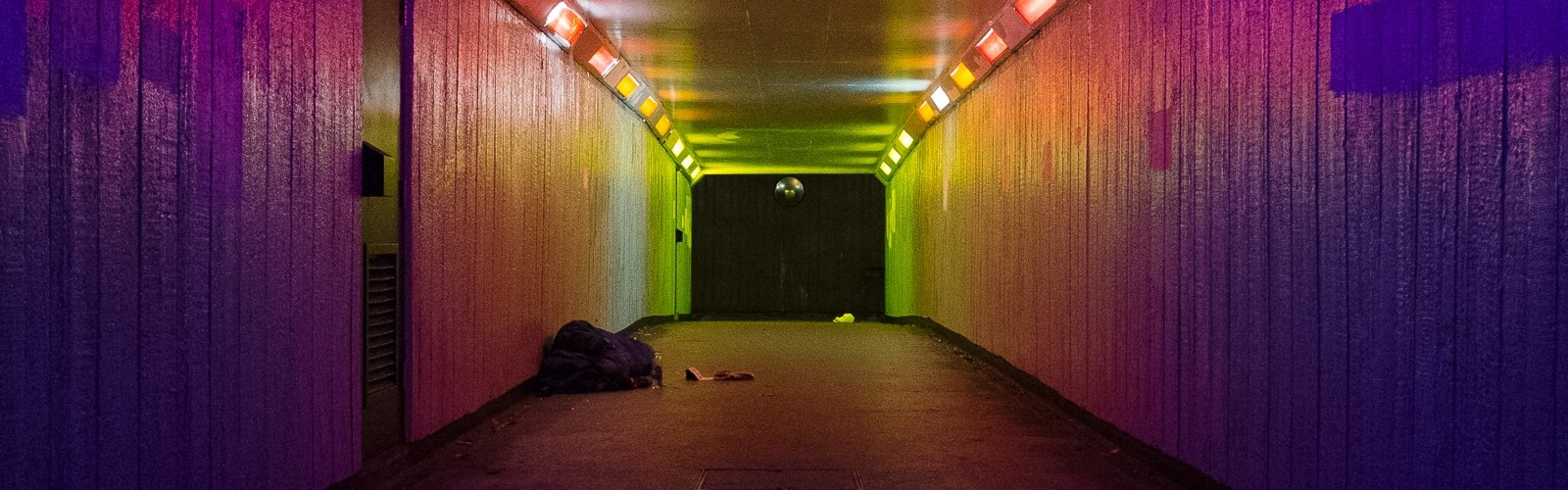 Image: subway with a rough sleeper at the far end