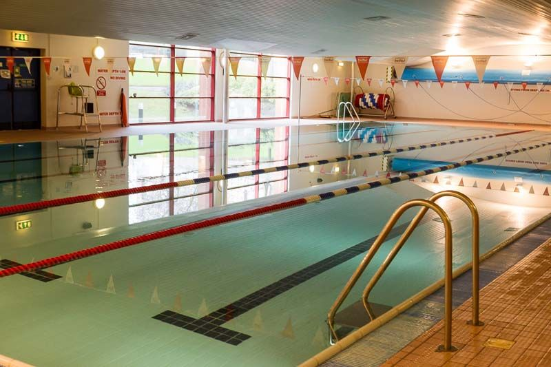 This shows the swimming pool located inside the University of Salford's sports centre. You can see the pool ladders and equipment surrounding it.