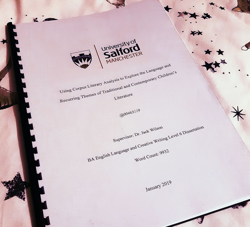 A photo of my personal dissertation. With the title 'Using Corpus Literary Analysis to Explore the Language and Recurring Themes of Traditional and Contemporary Children's Literature'
