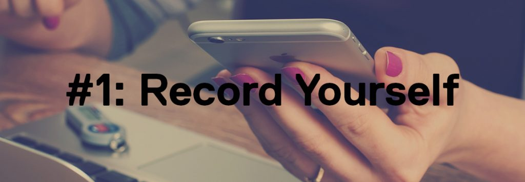 Photo by William Iven on Unsplash. The background shows a faded image of a woman with pink nails on her iphone. The foreground has the text '#1: Record Yourself'.