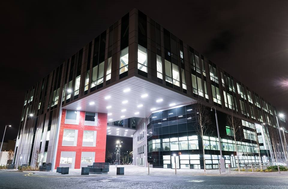 A nighttime shot of the New Adelphi Building which is situated on the main Peel Park Campus, near the roundabout adjacent to Salford Crescent train station.