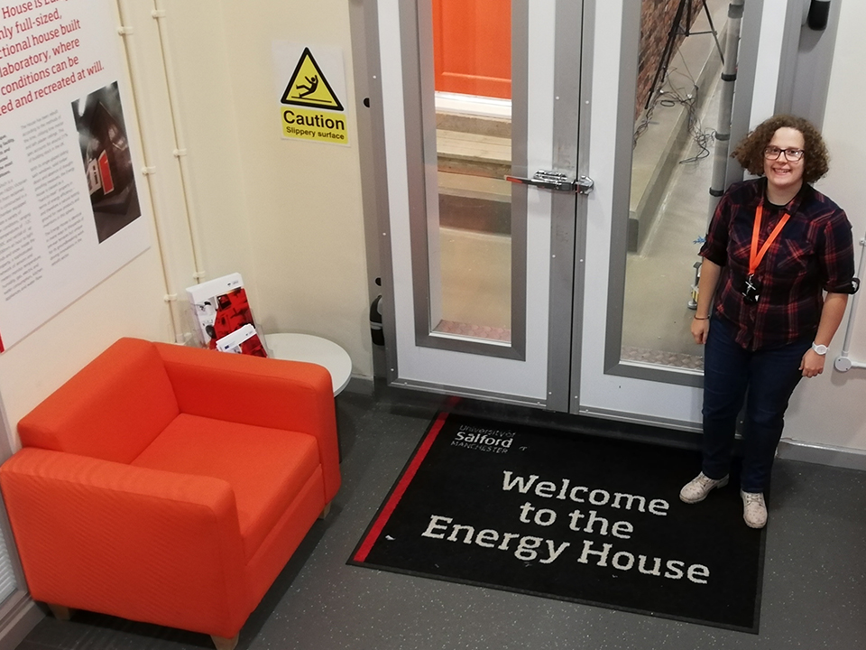 Placement student stood by the doors to Energy House