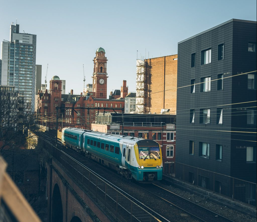 Train passing by the Manchester skyline