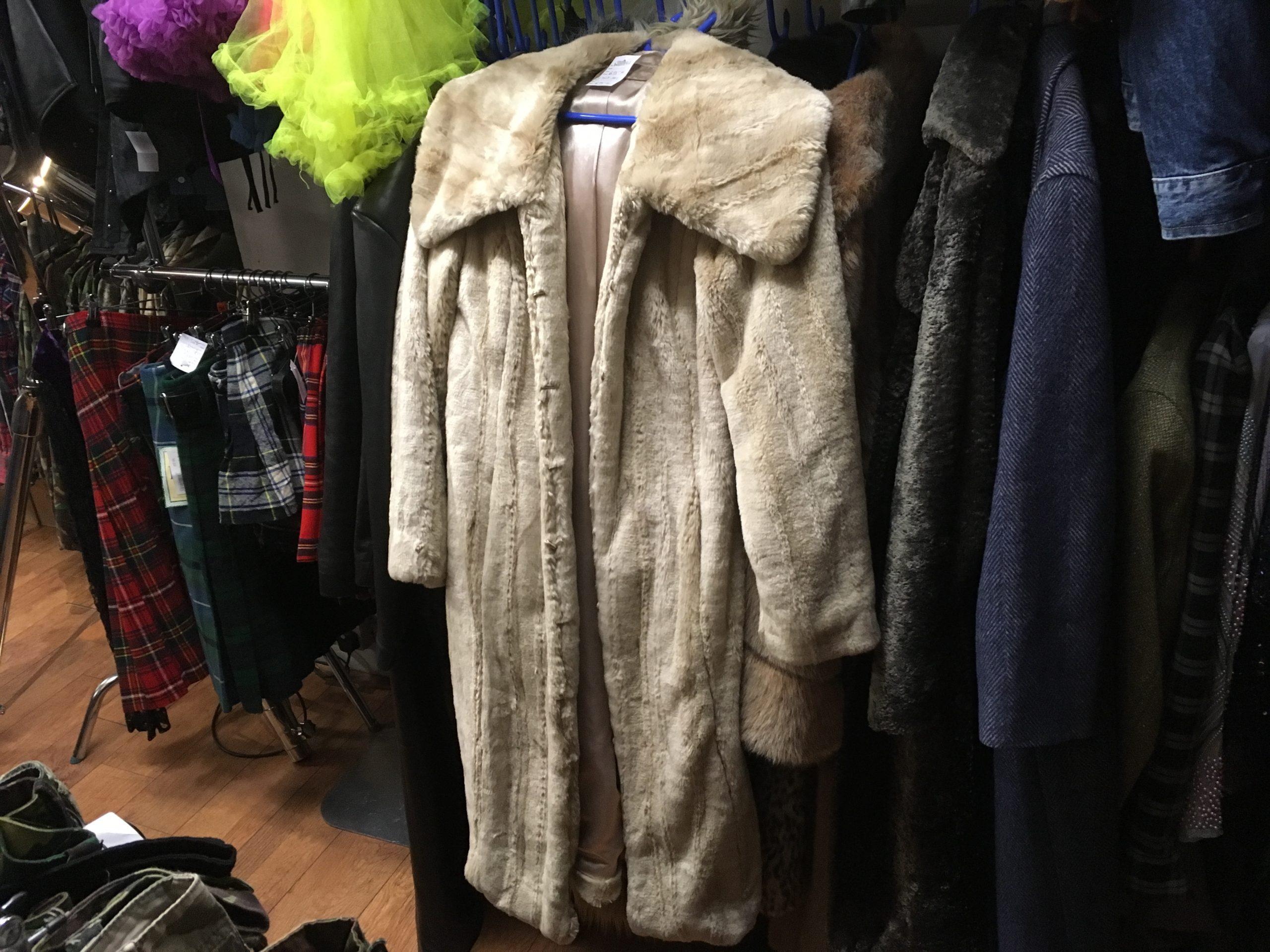 Faux fur coat on a hanger