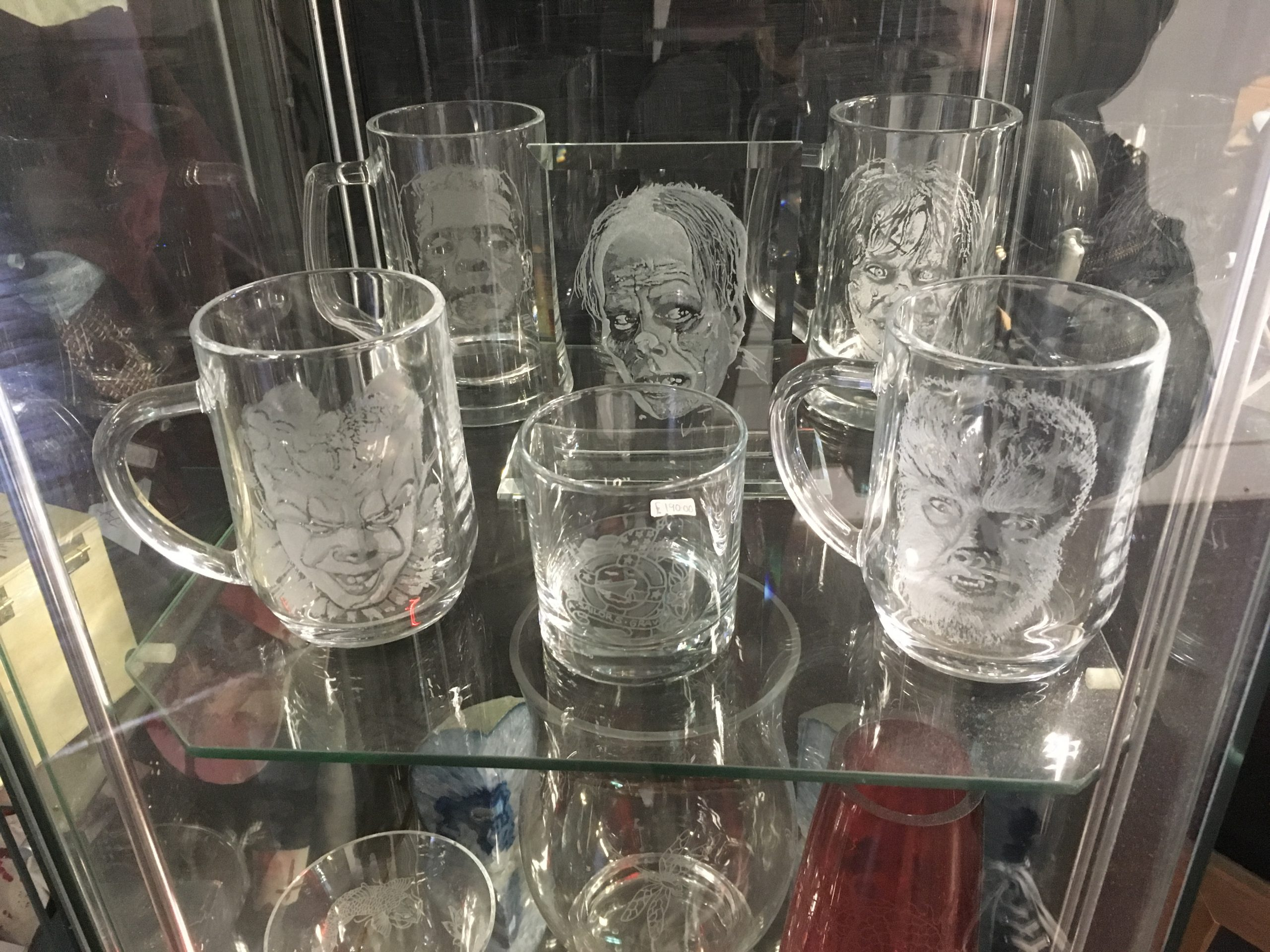 Engraved glasses with a variety of horror faces on them