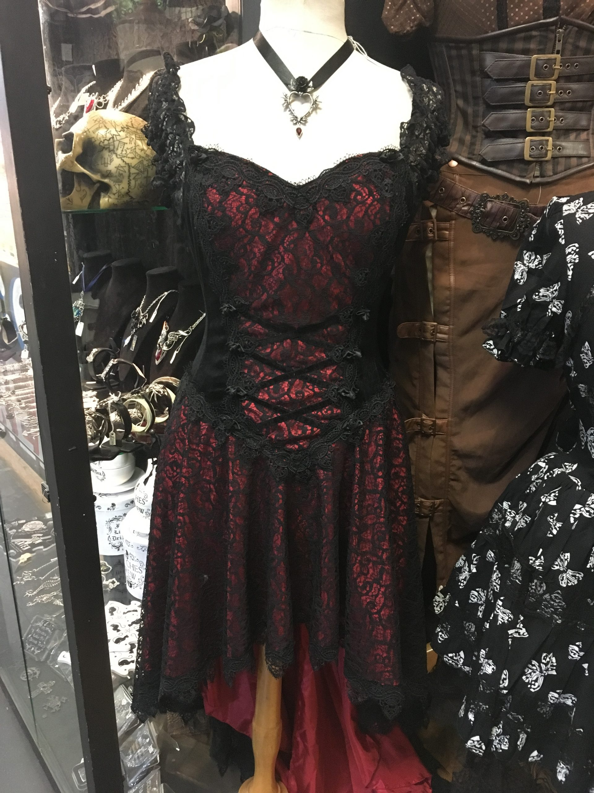 Steampunk dress with red material covered in black webbing