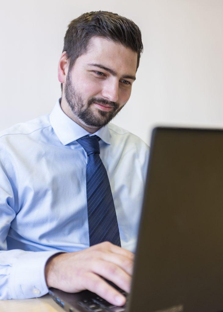 James Hodgson-Jones sat at his laptop