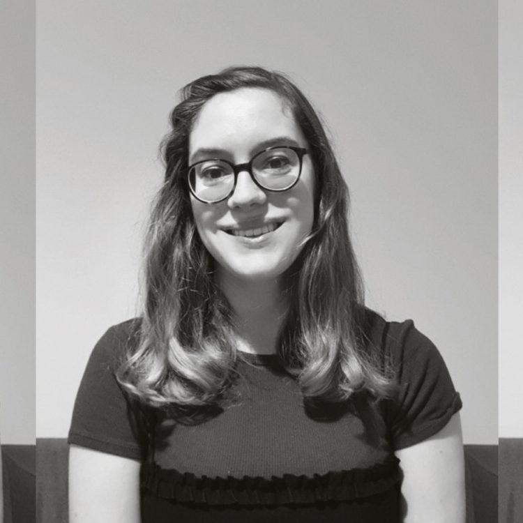 Black and white headshot of Ellie