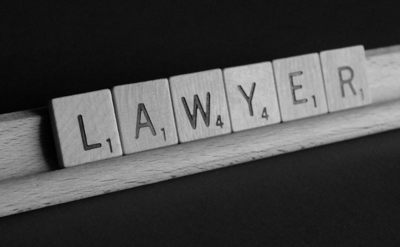 "Image of the word ""Lawyer"" spelt out with scrabble pieces"