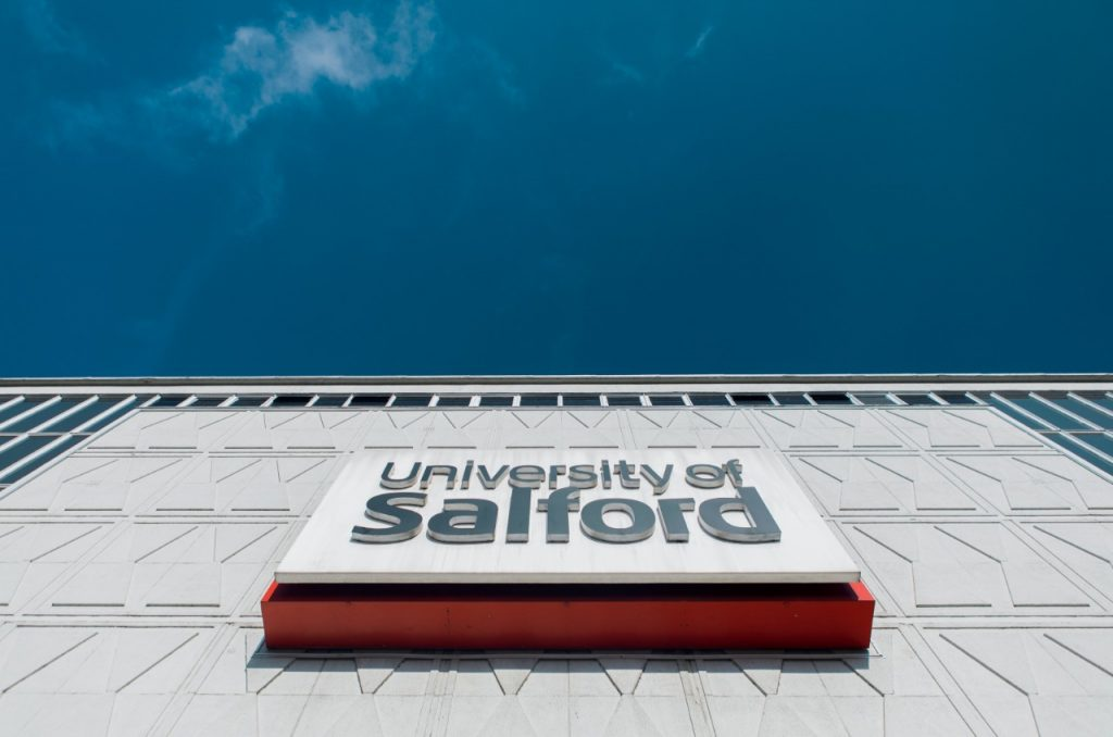 """Sign on a campus building that reads """"University of Salford"""""""