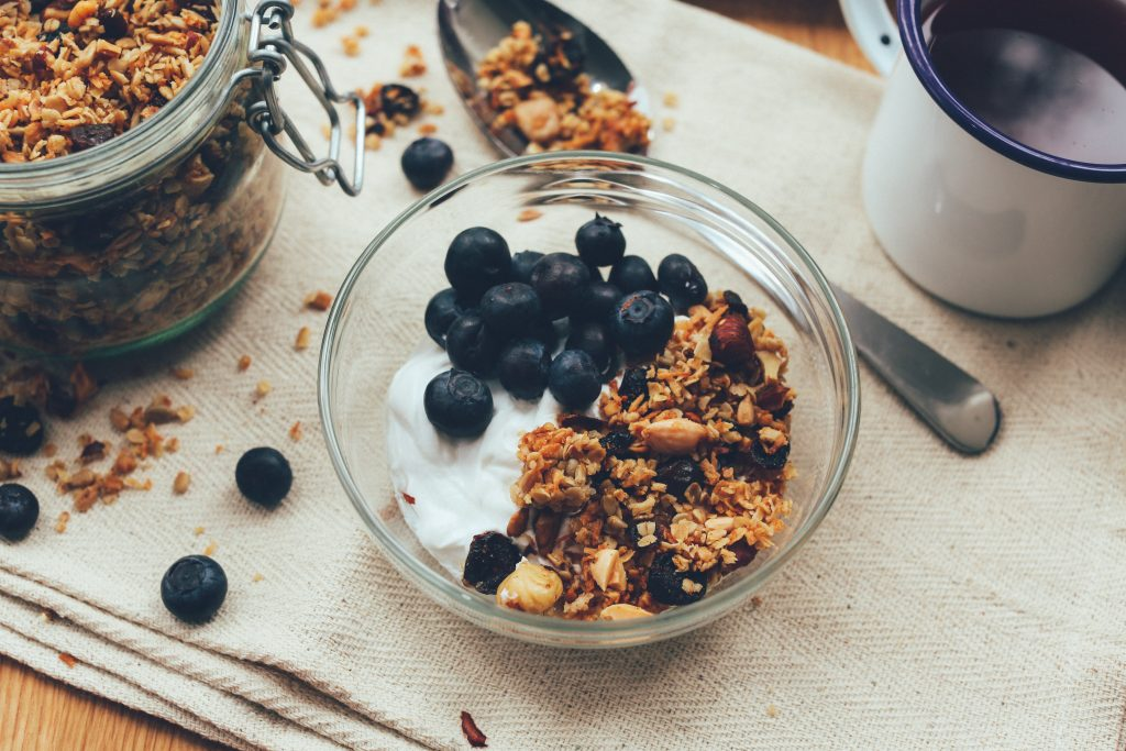 Image of a bowl of granola with blueberries.