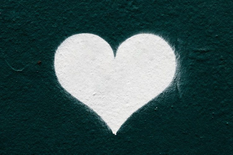 Image of white chalk heart on a dark background