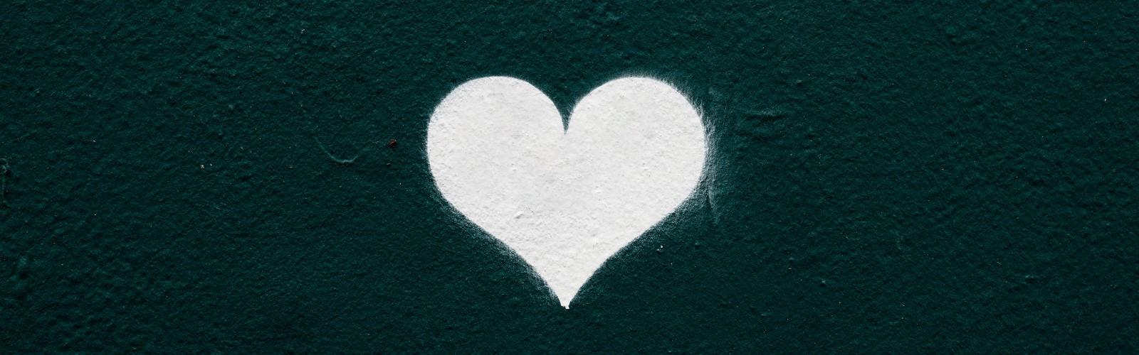 Image of white chalk heart on a dark background