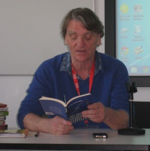 Photograph of academic reading novel at conference