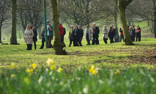 Photograph of people walking in a park