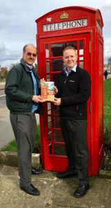 Profs Nigel Linge and Andy Sutton by phonebox